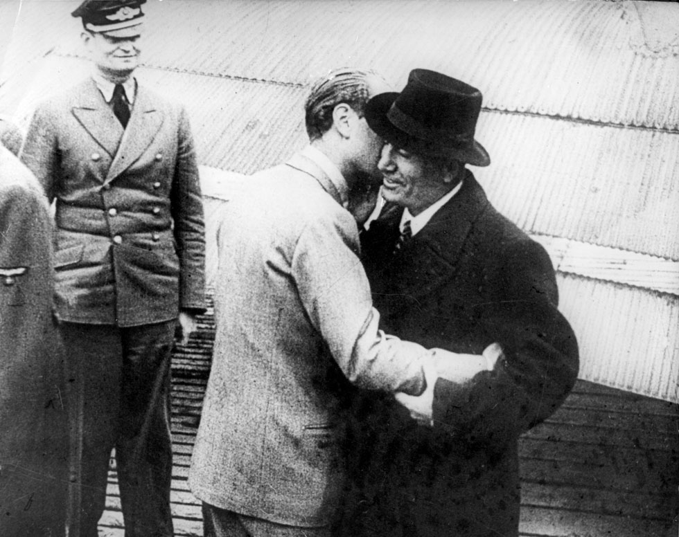 """An unidentified person kissing Benito Mussolini, deposed Duce, upon his arrival by plane on German territory following his """"Liberation"""" from a hotel in the small town of Assergi, Italy, by German paratroopers. The German radio announced Mussolini's arrival on Sept. 16, 1943. (AP Photo)"""