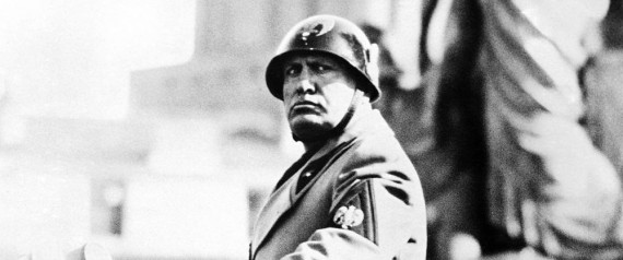 Italian dictator benito Mussolini celebrated the anniversary of the founding of the Fascist Militia by pinning medals for valor on to the standards of the battalions which took part in the Italo-Ethiopian war, at Rome. He also decorated the widows of men who fell in the war, and attended a special mass for them. Mussolini wearing an aggressive expression as he stands on the rostrum to watch Fascist Militia parade past during the anniversary celebrations, in Rome, on Feb. 3, 1937. (AP Photo) Only Italy--Prezzo speciale contattare: massimo.zanotti@lapresse.it--