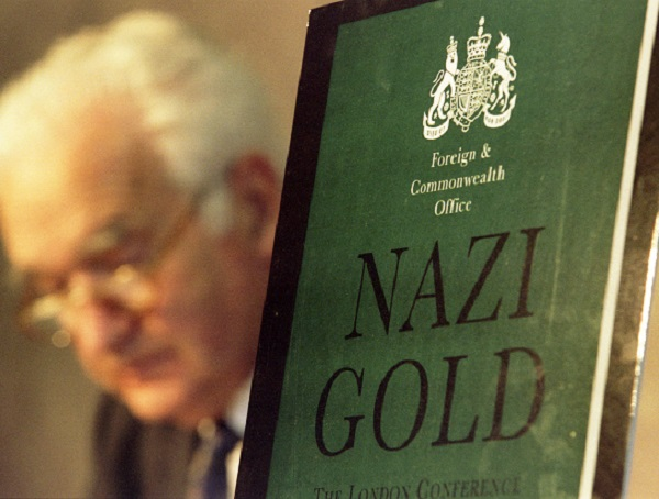 Lord MacKay looks down at his notes before announcing the publication of the report on the Nazi Gold Conference August 24. The conference, held in London last December, addressed the seizure of huge quantities of gold by the Nazis from central banks of countries they occupied during the Second World War and from individual victims of Nazi persecution. - RTXI2R3