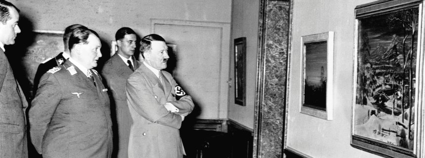 "ca. 1930s, Berlin, Germany --- Hermann Goering and Adolph Hitler examine a painting at what is probably the exhibit ""Entartete Kunst"" (Degenerate Art) put together by the Nazi party intending to illustrate that many artists were unworthy of the ""higher race"". --- Image by © CORBIS"