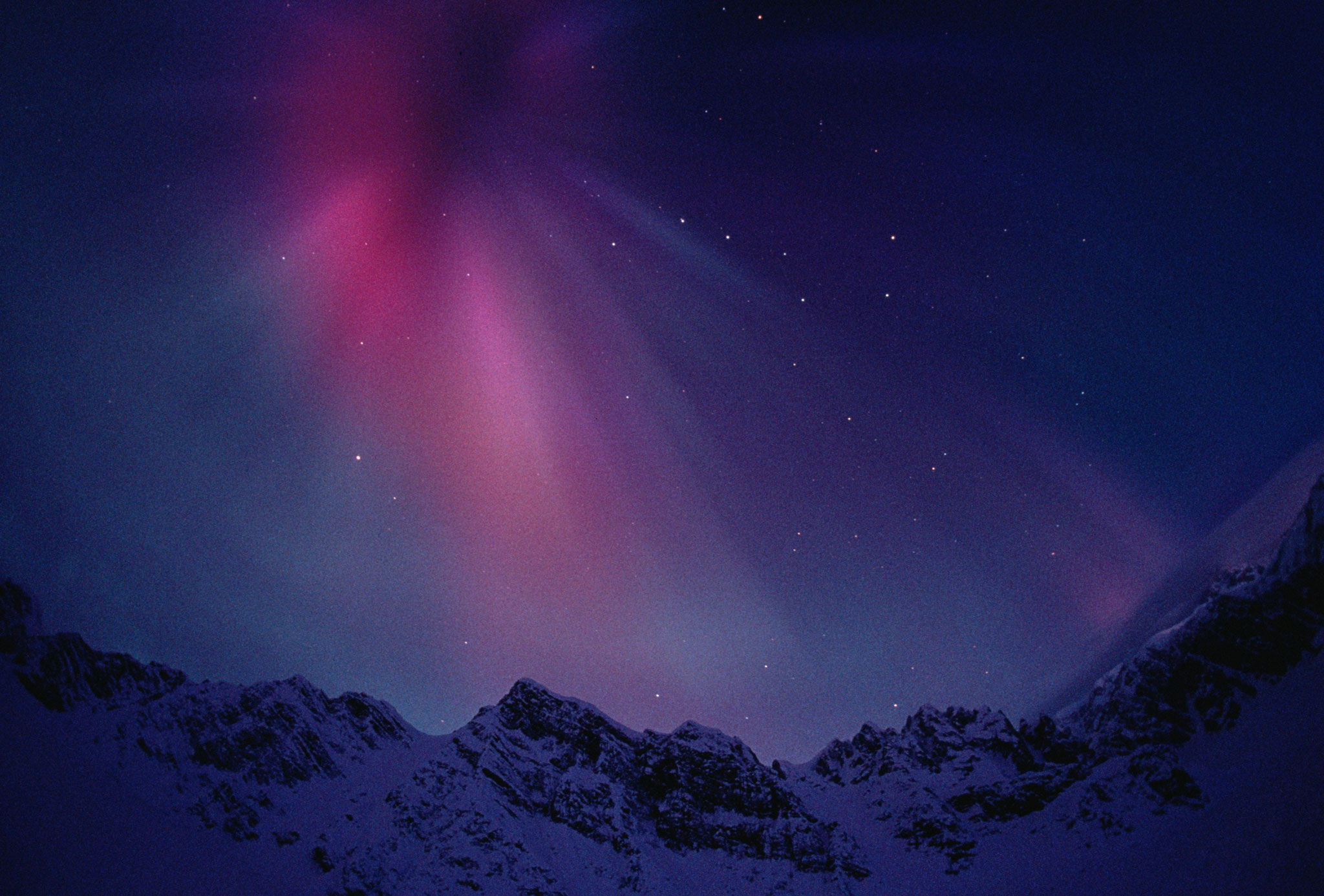 Aurora borealis over mountain range, Alaska